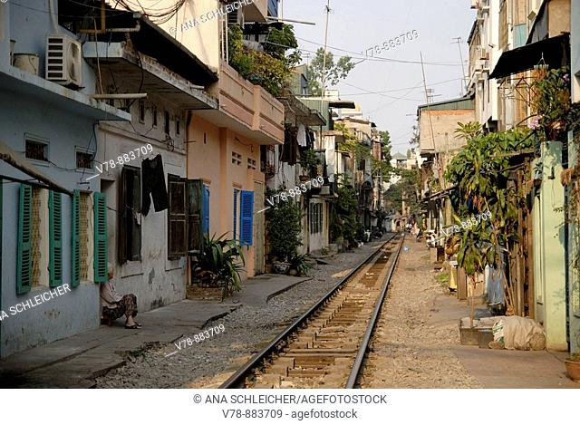 The rail tracks in the city centre of Hanoi run extremely close to teh houses. Since private houses couldn't have more than 2 floors, not to ofeend the king