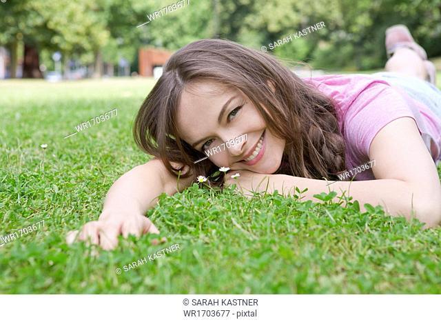 Woman lying on a meadow
