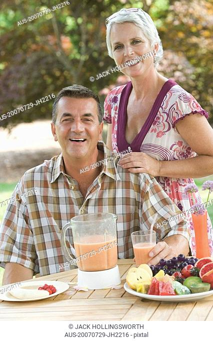 Portrait of a mature couple at a breakfast table and smiling