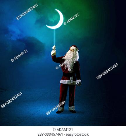 Santa Claus holding a string of luminous glowing moon