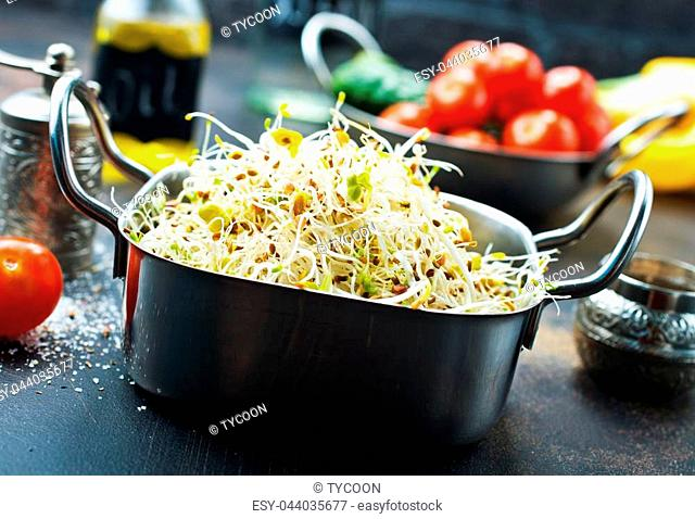 Raw fresh young organic sprouts in bowl