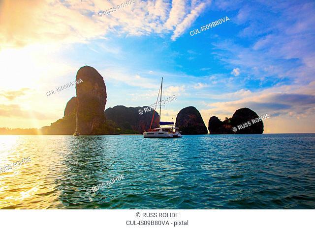 Yacht sailing on sea by cliff, Krabi, Thailand, Asia