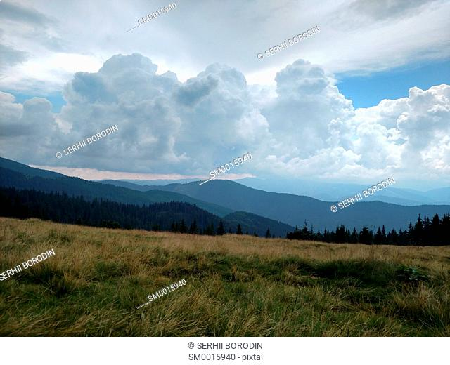 Mountains ate clouds and lawn Grassland with dry grass nature