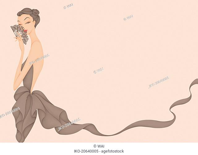 Beautiful woman flirting behind lace fan
