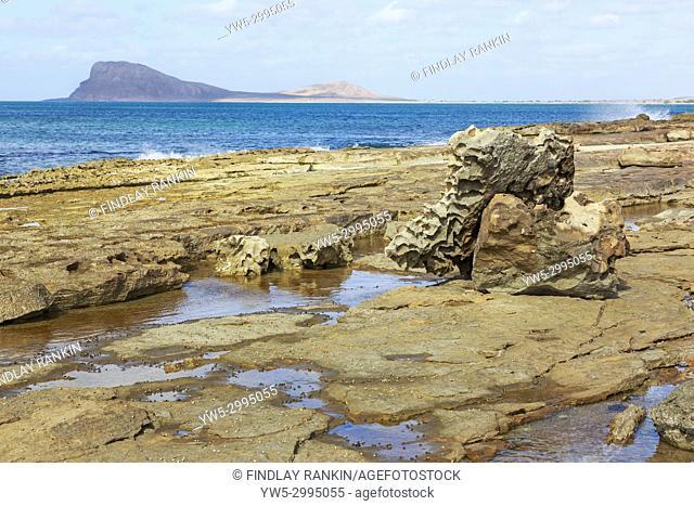 Coastline at Murdeira Bay , Baia da Murdeira, with Lion Mountain, Monte Leao on the horizon, Sal Island, Salina, Cape Verde, Africa