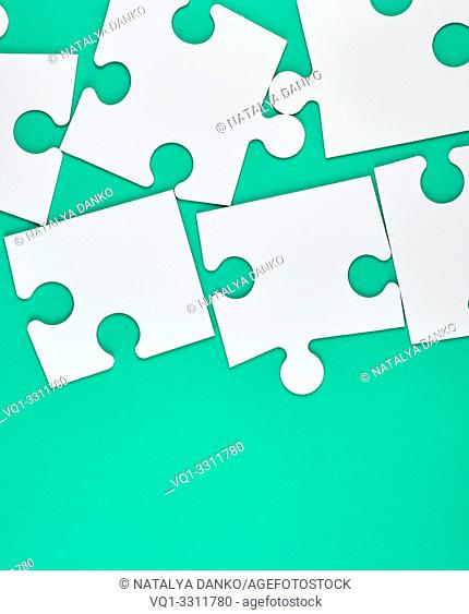 blank white big puzzles on green background, copy space