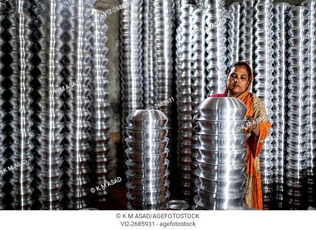 Woman work in an aluminum cookware factory in Dhaka Bangladesh May 08, 2016. Many Bangladeshi lower class people live in poverty level