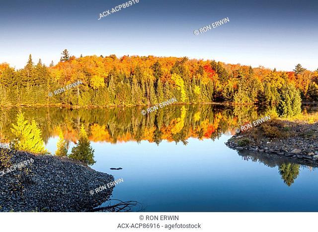Brilliant Autumn colours at Smoke Creek in Algonquin Provincial Park, Ontario, Canada