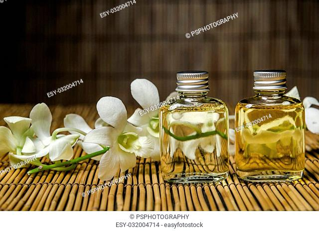 Concept of spa treatment with oil bottle and orchid
