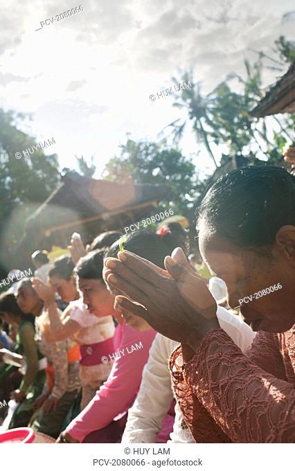 Women praying during Kuningan Festival; Bali, Indonesia