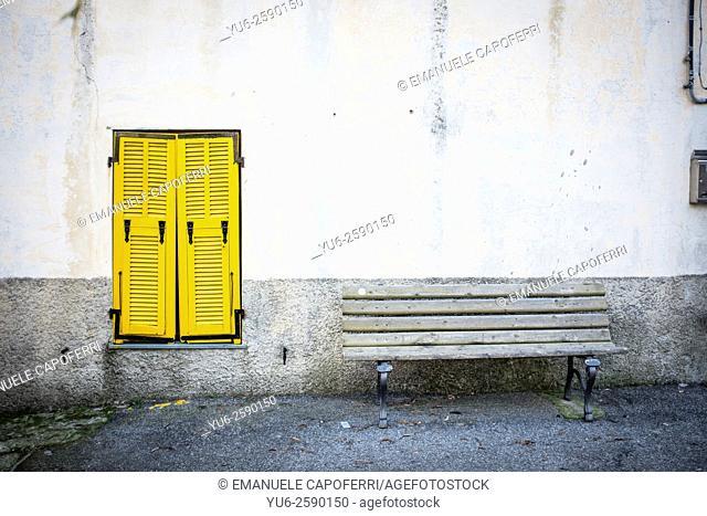 Bench and yellow window, Villatalla, Liguria, Italy