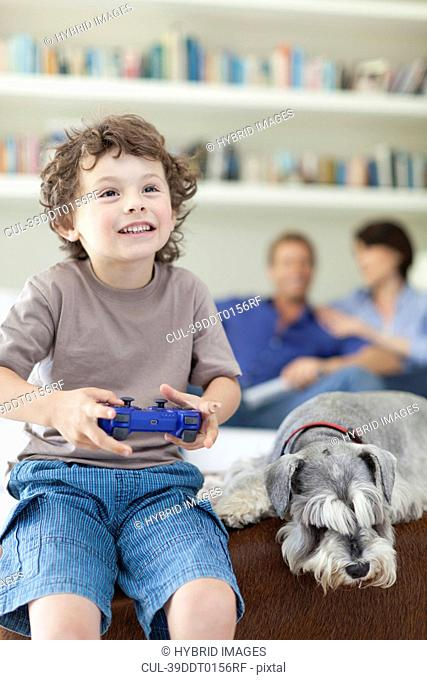 Boy playing video games in living room