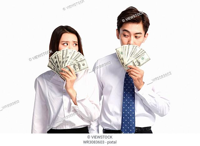 Business young men and women with the dollar