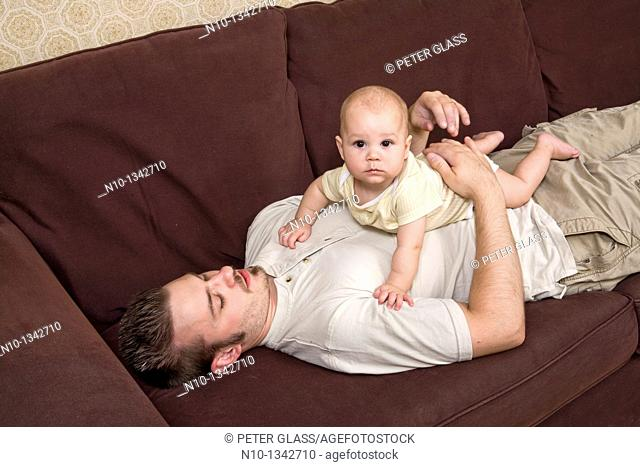Young father with his six-month old son