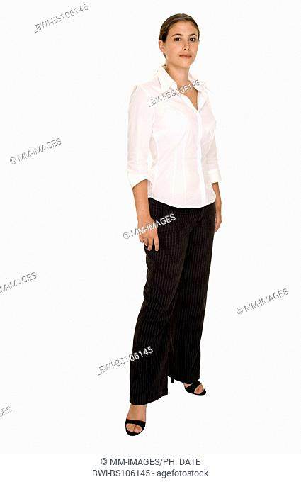 Young pretty businesswoman in pinstripe trousers and white blouse