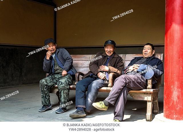 Three men, Temple of Confucius (Kong Miao), Qufu, Shandong province, the hometown of Confucius, China