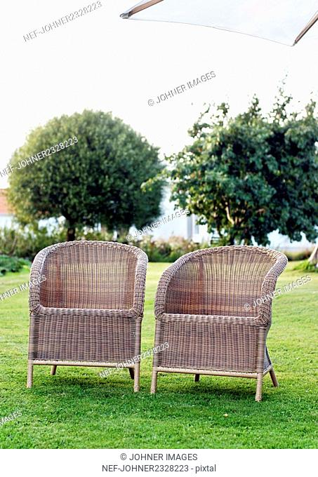 Wicker chairs in garden