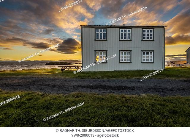 Midnight sun over house on Flatey Island, Borgarfjordur, Iceland