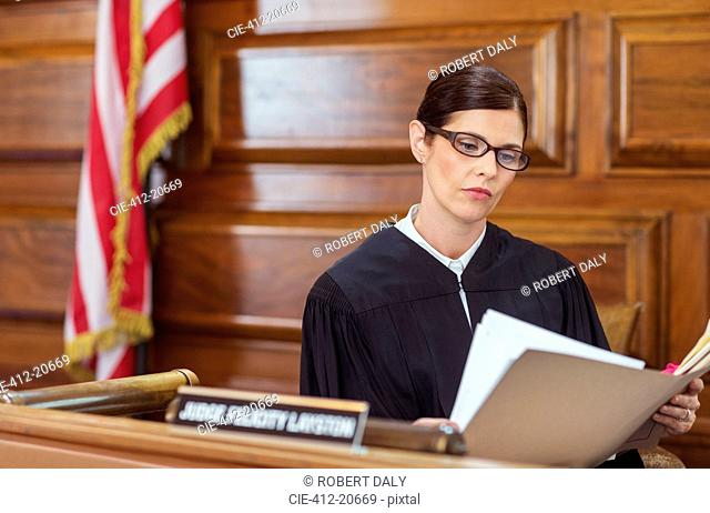 Judge looking through documents and judges bench