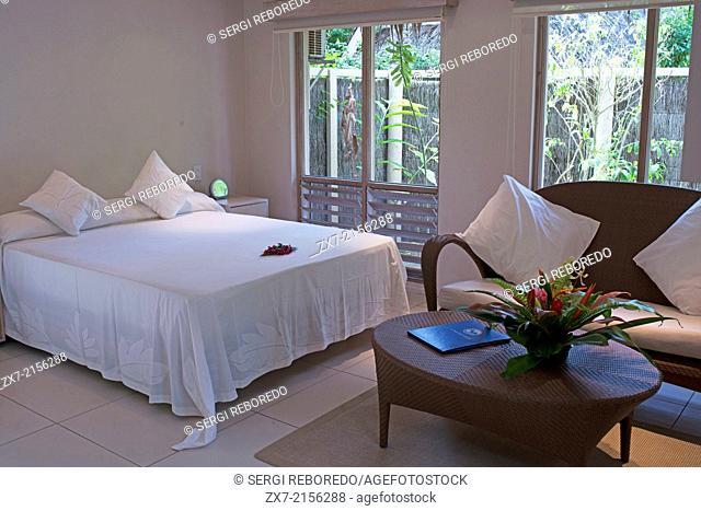 Rarotonga Island. Cook Island. Polynesia. South Pacific Ocean. Room and bed of luxury hotel Little Polynesian Resort in Rarotonga