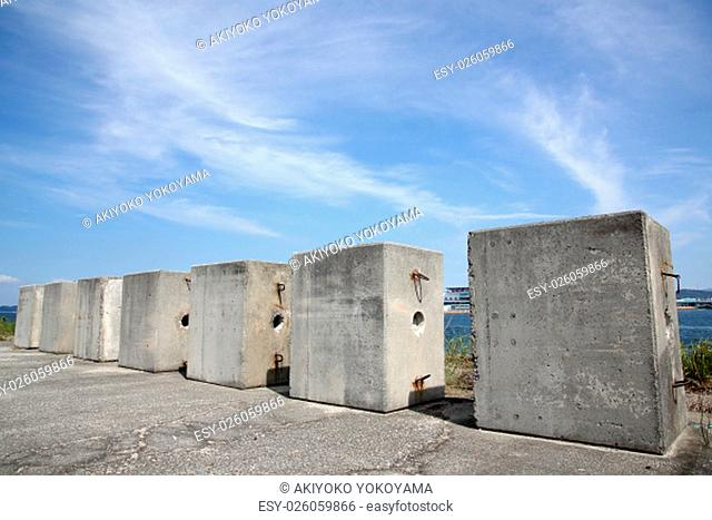 Heavy concrete weight against a blue sky