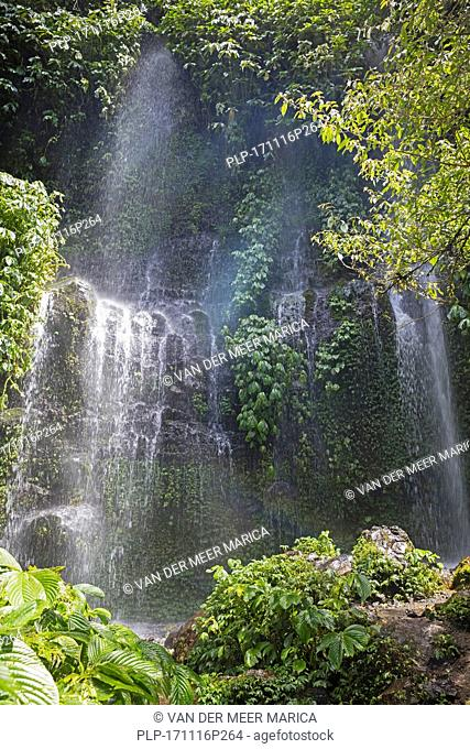 Benang Kelambu Waterfall in tropical forest near the village Aik Berik, North Batukliang, Central Lombok, Indonesia