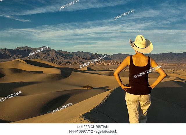 USA, California, Death Valley, National Park, cowgirl looking over sand dunes MR 0009