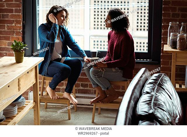 Lesbian couple having coffee