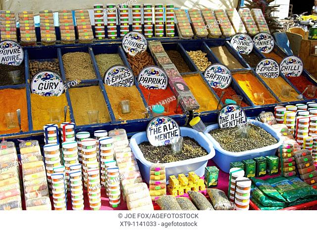 large range of various spices open and packaged on a stall at the market in nabeul tunisia