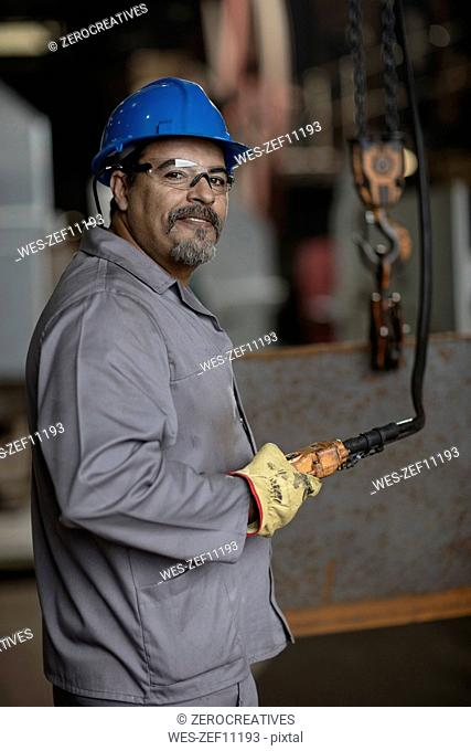 Engineer using control device in metal construction company