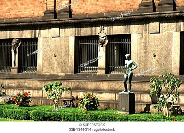 Statue in the courtyard of a museum, Ny Carlsberg Glyptotek, Copenhagen, Denmark
