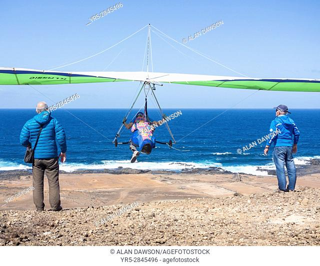Hang glider taking off at Las Coloradas, La Isleta, Las Palmas, Gran Canaria, Canary Islands