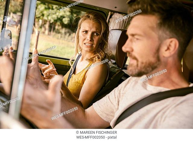 Couple arguing in van on a road trip