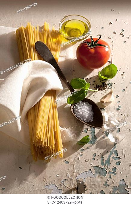 Ingredients for spaghetti with tomatoes and basil