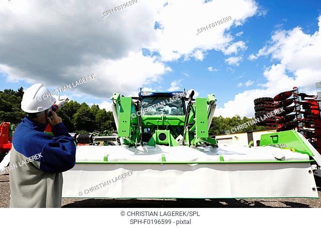 Mechanic with farming machinery