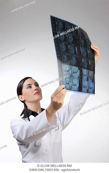 Female doctor examining an x-ray report
