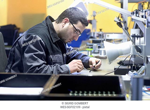 Man working in a sensor technology plant