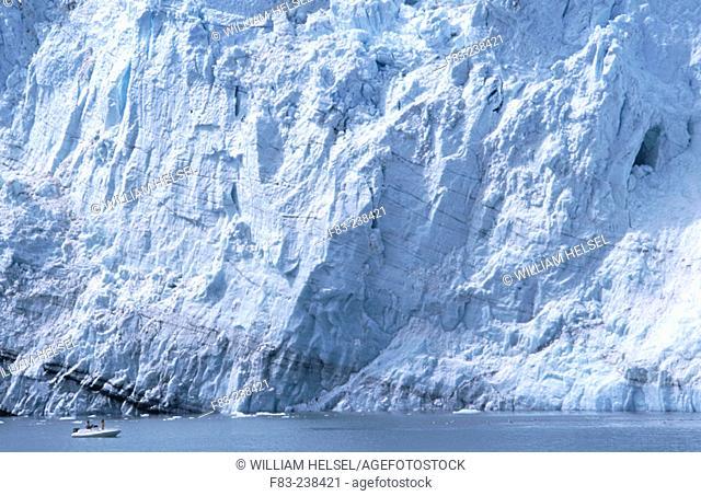 Face of Margerie Glacier, visitors in inflatable boat get close. Glacier Bay National Park. Alaska. USA