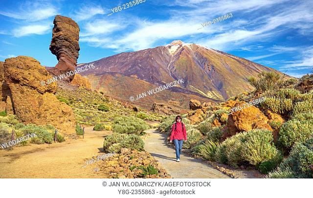 Tourist walking in Teide National Park, Tenerife, Canary Islands, Spain