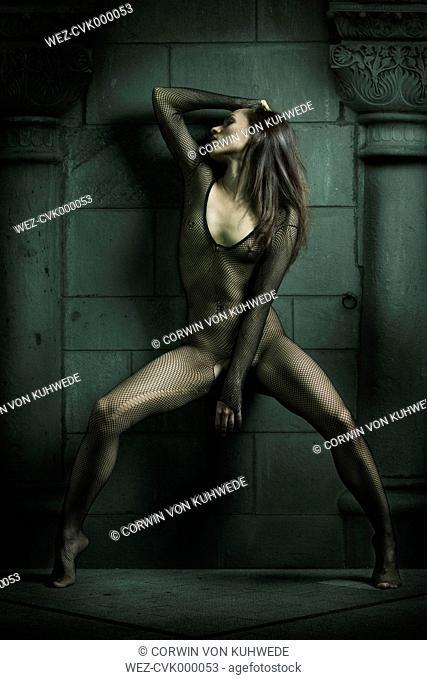 Young woman wearing bodystocking