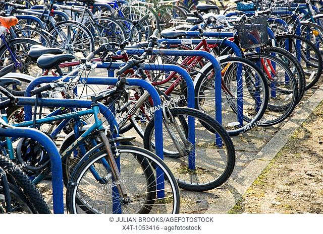 Rows of bicycles parked outside Oxford Station as part of an integrated environmental transport policy