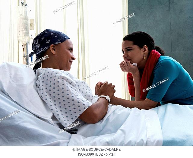 Daughter visiting mother in hospital