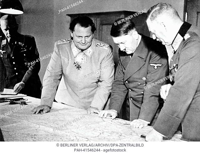 The image from the Nazi Propaganda! shows Adolf Hitler reviewing the military situation in the command bunker of Göring in Potsdam, Germany, date unknown