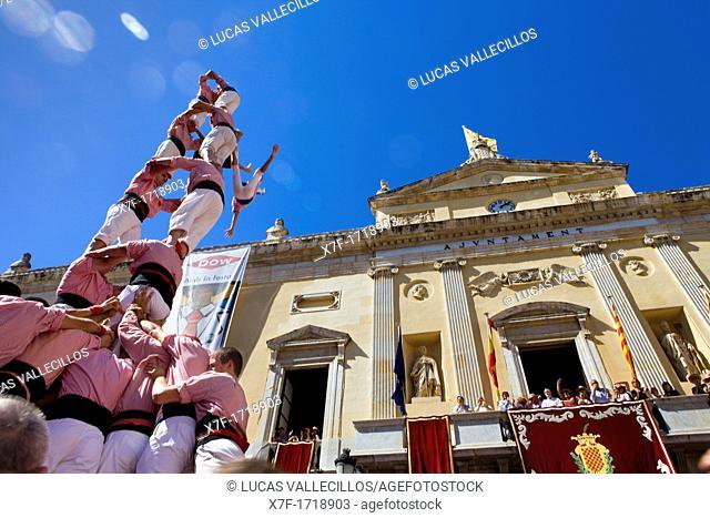 Xiquets de Tarragona Human tower falling  `Castellers' is a Catalan tradition Festa de Santa Tecla, city festival  Plaça de la Font Tarragona, Spain