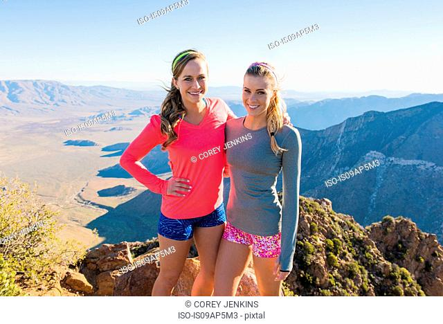 Portrait of two female trail running friends on Pacific Crest Trail, Pine Valley, California, USA