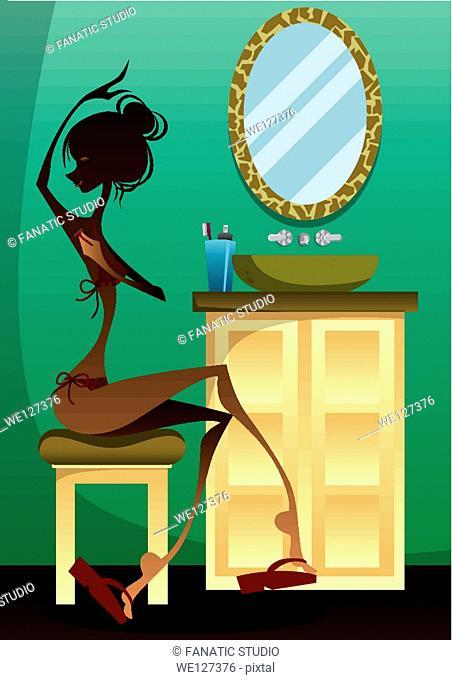 Woman shaving armpits