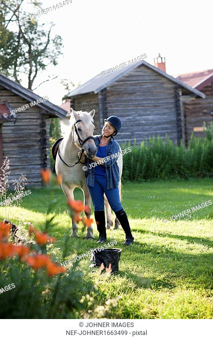 Mature woman with horse
