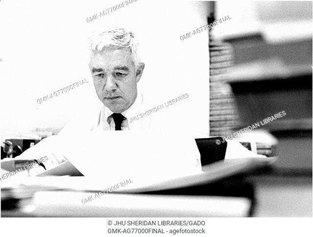 Professor of business history at Johns Hopkins University Alfred DuPont Chandler works at his desk, 1968