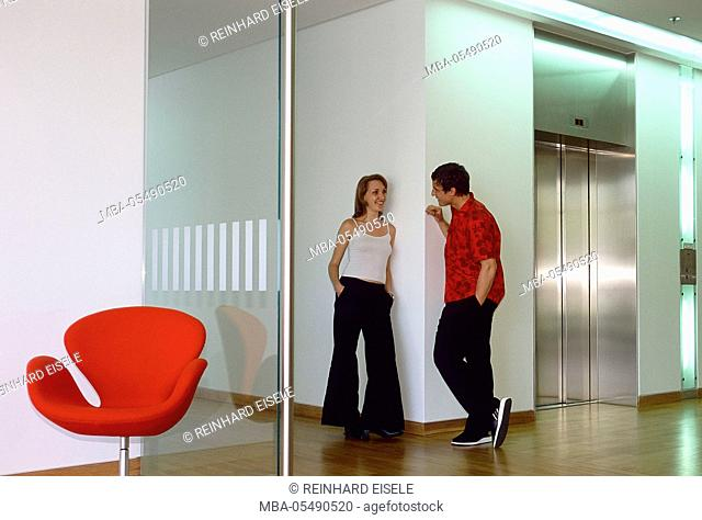 Young man and young woman at the conversation