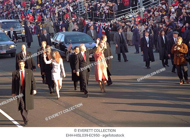 President Bill Clinton walk with Chelsea and Hillary in the 1997 Inaugural Parade. (BSLOC-2015-2-197)